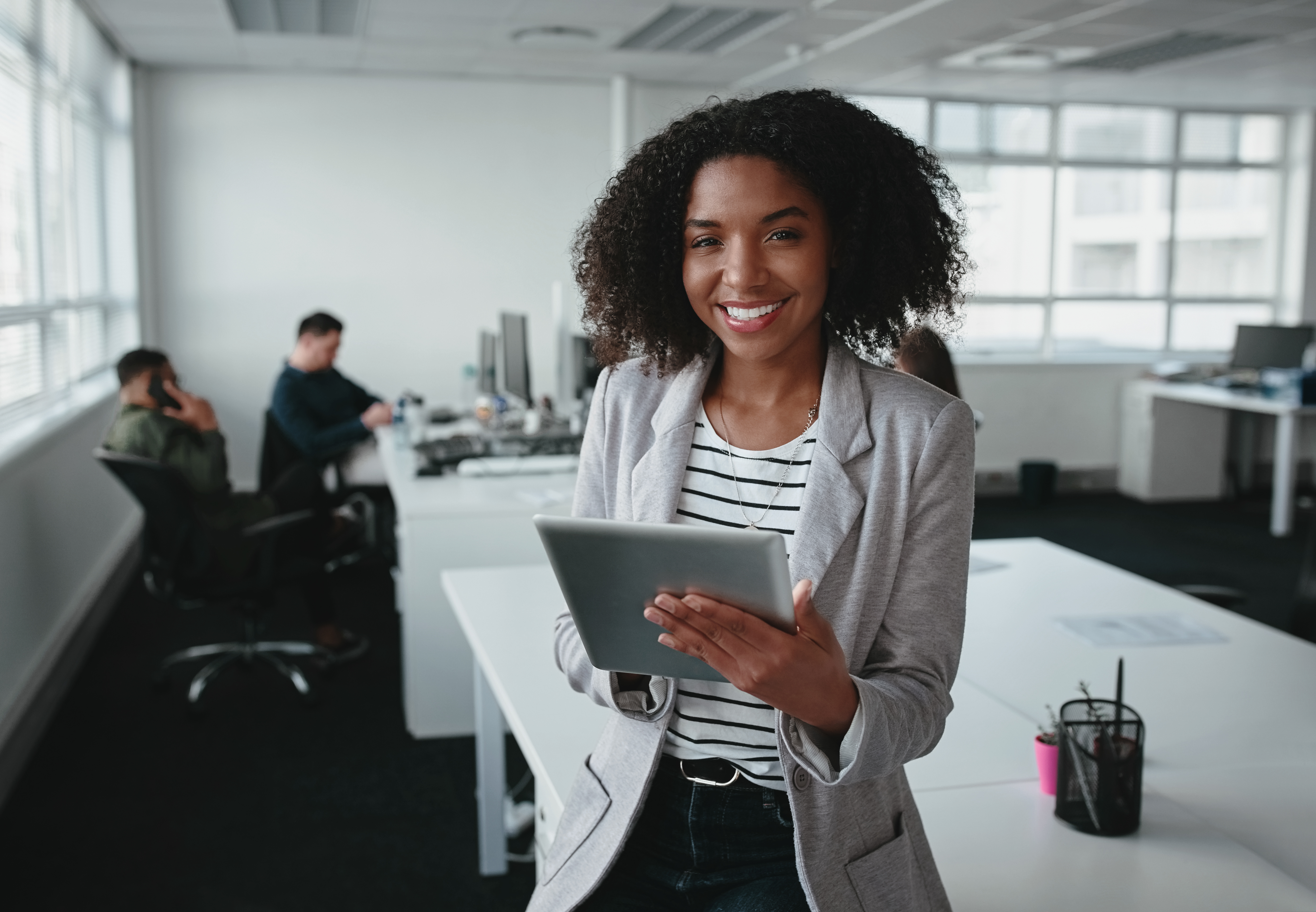 Human resources executive holding a tablet