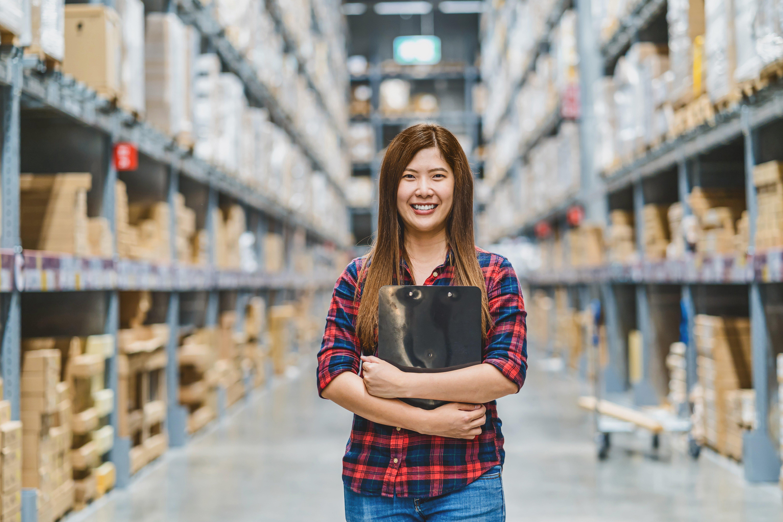 Happy female warehouse employee